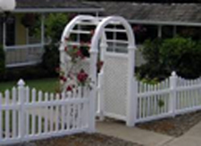White picket fence with arbor entrance