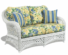White Wicker Loveseat with Floral Cushions